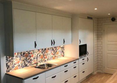 Renovert kjøkken stillig tapet og godt håndverk